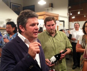 Alvaro Palacios (left) talks to a fan as one of The Wine House's partners looks on.